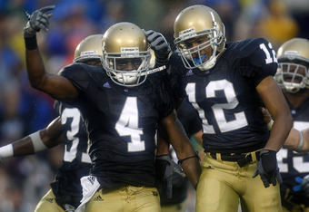SOUTH BEND, IN - SEPTEMBER 13:  Gary Gray #4 of the Notre Dame Fighting Irish is congratulated by Robert Blanton #12 after a fourth quarter interception while playing the Michigan Wolverines on September 13, 2008 at Notre Dame Stadium in South Bend, India