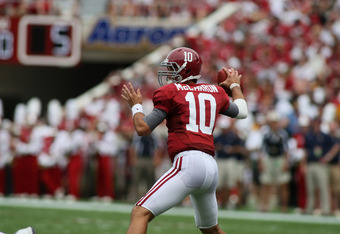 TUSCALOOSA, AL - SEPTEMBER 3:  Quarterback A.J. McCarron #10 of the Alabama Crimson Tide sets up to pass in second half action during the game with the Kent State Golden Flashes on September 3, 2011 at Bryant Denny Stadium in Tuscaloosa, Alabama.  Alabama