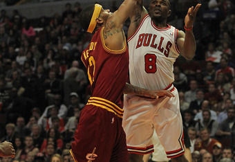 CHICAGO, IL - APRIL 26: Mike James #8 of the Chicago Bulls shoots over D.J. Kennedy #12 of the Cleveland Cavaliers at the United Center on April 26, 2012 in Chicago, Illinois. NOTE TO USER: User expressly acknowledges and agrees that, by downloading and o