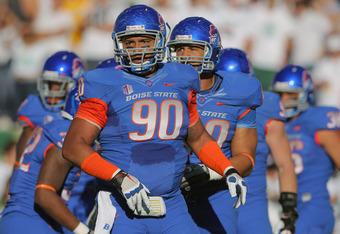 FORT COLLINS, CO - OCTOBER 15:  Billy Winn #90 and the Boise State Broncos defense face the Colorado State Rams at Sonny Lubick Field at Hughes Stadium on October 15, 2011 in Fort Collins, Colorado. The Broncos defeated the Rams 63-13.  (Photo by Doug Pen