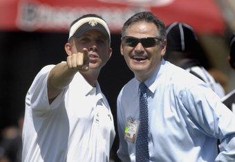 TAMPA, FL - SEPTEMBER 16: Coach Sean Payton and general manager Mickey Loomis of  the New Orleans Saints check the sidelines during warm ups before play against the Tampa Bay Buccaneers during a week-two NFL game on September 16, 2007 in Tampa, Florida.