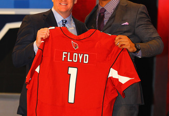 NEW YORK, NY - APRIL 26:  Michael Floyd (R) of Notre Dame holds up a jersey as he stands on stage with NFL Commissioner Roger Goodell after he was selected #13 overall by the Arizona Cardinals in the first round of the 2012 NFL Draft at Radio City Music H
