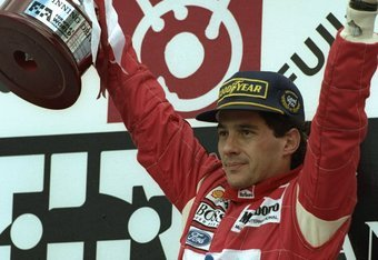24 Oct 1993:  McLaren Ford driver Ayrton Senna of Brazil holds the trophy aloft after his victory in the Japanese Grand Prix at the Suzuka circuit in Japan.  \ Mandatory Credit: Pascal  Rondeau/Allsport
