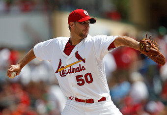 JUPITER, FL - MARCH 18:  Adam Wainwright #50 of the St. Louis Cardinals pitches during a game against the Miami Marlins at Roger Dean Stadium on March 18, 2012 in Jupiter, Florida.  (Photo by Sarah Glenn/Getty Images)