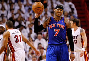 MIAMI, FL - APRIL 30:  Carmelo Anthony #7 of the New York Knicks reacts to committing a foul during Game Two of the Eastern Conference Quarterfinals in the 2012 NBA Playoffs  against the Miami Heatat American Airlines Arena on April 30, 2012 in Miami, Flo