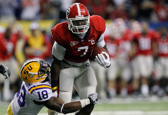 ATLANTA, GA - DECEMBER 03:  Orson Charles #7 of the Georgia Bulldogs runs for yards after the catch against Brandon Taylor #18 of the LSU Tigers during the first half of the 2011 SEC Conference Championship at  Georgia Dome on December 3, 2011 in Atlanta,