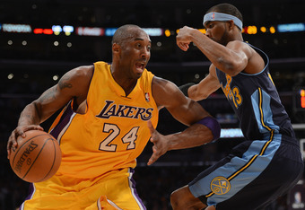 LOS ANGELES, CA - MAY 01:  Kobe Bryant #24 of the Los Angeles Lakers drives on Corey Brewer #13 of the Denver Nuggets during Game Two of the Western Conference Quarterfinals in the 2012 NBA Playoffs at Staples Center on May 1, 2012 in Los Angeles, Califor