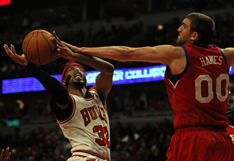 CHICAGO, IL - MAY 01:  Richard Hamilton #32 of the Chicago Bulls tries to get off a a shot against Spencer Hawes #00 of the Philadelphia 76ers in Game Two of the Eastern Conference Quarterfinals during the 2012 NBA Playoffs at the United Center on May 1,