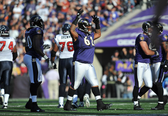 BALTIMORE - OCTOBER 16:  Terrence Cody #62 of the Baltimore Ravens celebrates a fumble recovery against the Houston Texans at M&T Bank Stadium on October 16. 2011 in Baltimore, Maryland. The Ravens lead the Texans 10-7 at the half. (Photo by Larry French/
