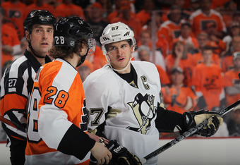 PHILADELPHIA, PA - APRIL 15:  Sidney Crosby #87 of the Pittsburgh Penguins speaks with Claude Giroux #28 of the Philadelphia Flyers in Game Three of the Eastern Conference Quarterfinals during the 2012 NHL Stanley Cup Playoffs at Wells Fargo Center on Apr