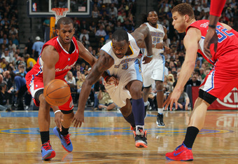 DENVER, CO - APRIL 18:  Ty Lawson #3 of the Denver Nuggets looses control of the ball against Chris Paul #3 and Blake Griffin #32 of the Los Angeles Clippers at Pepsi Center on April 18, 2012 in Denver, Colorado. The Clippers defeated the Nuggets 104-98.