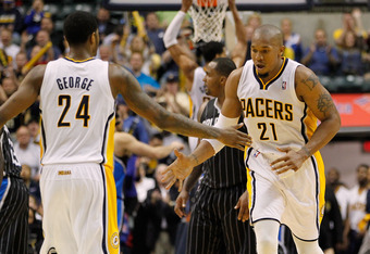 INDIANAPOLIS, IN - APRIL 30: David West #21 of the Indiana Pacers celebrates a fourth quarter basket with Paul George #24 while playing the Orlando Magic in Game Two of the Eastern Conference Quarterfinals during the 2012 NBA Playoffs on April 30, 2012 at