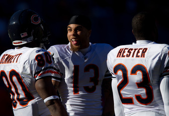DENVER, CO - DECEMBER 11:  Johnny Knox #13 of the Chicago Bears shares a laugh with Earl Bennett #80 and Devin Hester before a game against the Denver Broncos at Sports Authority Field at Mile High on December 11, 2011 in Denver, Colorado. (Photo by Justi