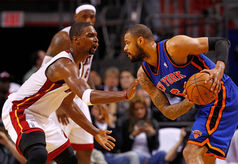 MIAMI, FL - APRIL 30: Tyson Chandler #6 of the New York Knicks posts up Chris Bosh #1 of the Miami Heat during Game Two of the Eastern Conference Quarterfinals in the 2012 NBA Playoffs  at American Airlines Arena on April 30, 2012 in Miami, Florida. NOTE