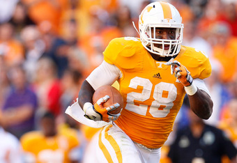 KNOXVILLE, TN - OCTOBER 15:  Tauren Poole #28 of the Tennessee Volunteers against LSU Tigers at Neyland Stadium on October 15, 2011 in Knoxville, Tennessee.  (Photo by Kevin C. Cox/Getty Images)