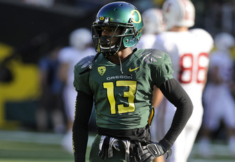 EUGENE, OR - OCTOBER 2: Cornerback Cliff Harris #13 of the Oregon Ducks warms before the start of the game at Autzen Stadium on October 2, 2010 in Eugene, Oregon. Oregon won the game 52-31. (Photo by Steve Dykes/Getty Images)