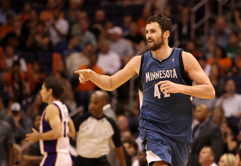 PHOENIX, AZ - MARCH 12:  Kevin Love #42 of the Minnesota Timberwolves reacts after hitting a three point shot past Steve Nash #13 of the Phoenix Suns during the NBA game at US Airways Center on March 12, 2012 in Phoenix, Arizona. The Timberwolves defeated