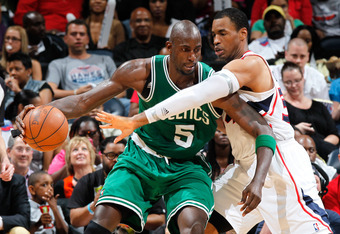 ATLANTA, GA - MAY 01:  Kevin Garnett #5 of the Boston Celtics drives against Jason Collins #34 of the Atlanta Hawks in Game Two of the Eastern Conference Quarterfinals in the 2012 NBA Playoffs at Philips Arena on May 1, 2012 in Atlanta, Georgia.  NOTE TO