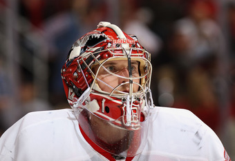 GLENDALE, AZ - JANUARY 19:  Goaltender Jimmy Howard #35 of the Detroit Red Wings in action during the NHL game against the Phoenix Coyotes at Jobing.com Arena on January 19, 2011 in Glendale, Arizona. The Red Wings defeated the Coyotes 3-2 in an overtime