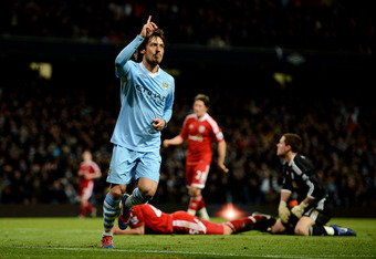 MANCHESTER, ENGLAND - APRIL 11:  David Silva of Manchester City celebrates scoring his team's fourth goal during the Barclays Premier League match between Manchester City and West Bromwich Albion at the Etihad Stadium on April 11, 2012 in Manchester, Engl