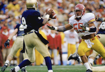 SOUTH BEND, IN - OCTOBER 21:  Junior Seau #55 of the University of Southern California Trojans rushes the quarterback of the University of Notre Dame Fighting Irish during the NCAA game on October 21, 1989 in South Bend, Indiana The Notre Dame won 28-24.