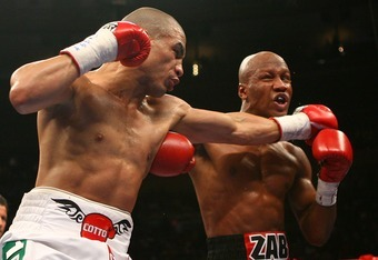 NEW YORK - JUNE 09:  Miguel Cotto of Puerto Rico lands a left jab on Zab Judah during their WBA Welterweight Championship bout on June 9, 2007 at Madison Square Garden in New York City.  (Photo by Nick Laham/Getty Images)
