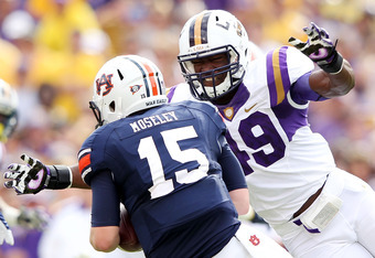 BATON ROUGE, LA - OCTOBER 22:  Barkevious Mingo #49 of the LSU Tigers sacks quarterback Clint Moseley #15 of the Auburn Tigers during the game at Tiger Stadium on October 22, 2011 in Baton Rouge, Louisiana.  (Photo by Jamie Squire/Getty Images)