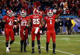 CHARLOTTE, NC - DECEMBER 27:  David Amerson #1 of the North Carolina State Wolfpack celebrates after an interception to end their game and defeat Louisville Cardinals 31-24 at Bank of America Stadium on December 27, 2011 in Charlotte, North Carolina.  (Ph