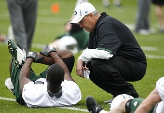 FLORHAM PARK, NJ - MAY 04:  New York Jets head coach Rex Ryan talks with Terrance Ganaway during the Jets Rookie Minicamp on May 4, 2012 in Florham Park, New Jersey.  (Photo by Jeff Zelevansky/Getty Images)