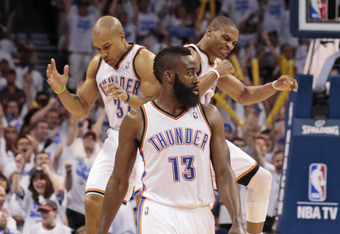 OKLAHOMA CITY, OK - APRIL 30:  Russell Westbrook #0 and Derek Fisher #37 celebrate a three-point shot assisted by James Harden #13 of the Oklahoma City Thunder against the Dallas Mavericks in Game Two of the Western Conference Quarterfinals in the 2012 NB