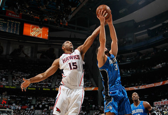 ATLANTA, GA - APRIL 22:  Al Horford #15 of the Atlanta Hawks against Ryan Anderson #33 of the Orlando Magic during Game Three of the Eastern Conference Quarterfinals in the 2011 NBA Playoffs at Philips Arena on April 22, 2011 in Atlanta, Georgia.  NOTE TO