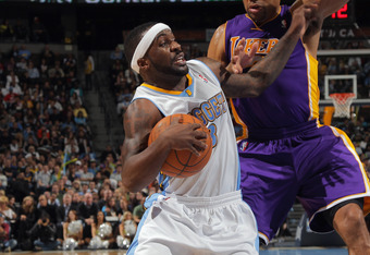 DENVER, CO - FEBRUARY 03:  Ty Lawson #3 of the Denver Nuggets drives with the ball against Derek Fisher #2 of the Los Angeles Lakers at the Pepsi Center on February 3, 2012 in Denver, Colorado. NOTE TO USER: User expressly acknowledges and agrees that, by