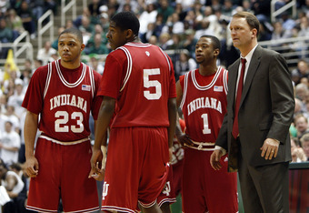 EAST LANSING, MI - MARCH 02:  Dan Dakich head coach of the Indiana Hoosiers talks with Armon Basett #1, Jordan Crawford #5 and Eric Gordon #23 during a game against the Michigan State Spartans at the Breslin Center March 2, 2008 in East Lansing, Michigan.