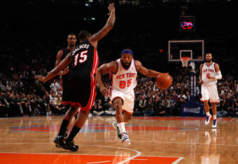 NEW YORK, NY - MAY 03:  Baron Davis #85 of the New York Knicks drives in the first quarter against Mario Chalmers #15 of the Miami Heat in Game Three of the Eastern Conference Quarterfinals in the 2012 NBA Playoffs on May 3, 2012 at Madison Square Garden
