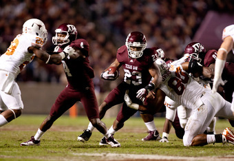 COLLEGE STATION, TX - NOVEMBER 24:  Ben Malena #23 of the Texas A&M Aggies rushes against the Texas Longhorns in the first half of a game at Kyle Field on November 24, 2011 in College Station, Texas. (Photo by Darren Carroll/Getty Images)