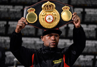 Floyd Mayweather brought home more than just another title belt Saturday night.