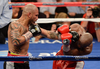 Miguel Cotto's cuts and bumps are a small price to pay for the chunk of cash he reeled in for fighting undefeated Floyd Mayweather.