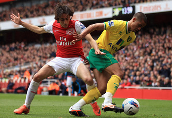 LONDON, ENGLAND - MAY 05:  Yossi Benayoun of Arsenal battles with Kyle Naughton of Norwich City during the Barclays Premier League match between Arsenal and Norwich City at the Emirates Stadium on May 5, 2012 in London, England.  (Photo by Bryn Lennon/Get
