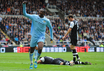 NEWCASTLE UPON TYNE, ENGLAND - MAY 06:  Yaya Toure of Manchester City celebrates scoring to make it 2-0 during the Barclays Premier League match between Newcastle United and Manchester City at the Sports Direct Arena on May 6, 2012 in Newcastle upon Tyne,
