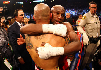 LAS VEGAS, NV - MAY 05:  Miguel Cotto hugs Floyd Mayweather Jr. and Mayweather Jr. defeats Cotto by unanimous decision during their WBA super welterweight title fight at the MGM Grand Garden Arena on May 5, 2012 in Las Vegas, Nevada.  (Photo by Al Bello/G