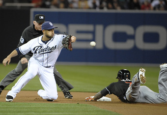 SAN DIEGO, CA - MAY 4:  Jose Reyes #7 of the Miami Marlins slides safely into second base with a double ahead of the tag of Jason Bartlett #8 of during the fourth inning of a baseball game at Petco Park on May 4, 2012 in San Diego, California.  (Photo by