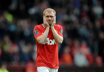 MANCHESTER, ENGLAND - MAY 06:  Paul Scholes of Manchester United looks dejected at the end of the Barclays Premier League match between Manchester United and Swansea City at Old Trafford on 6 May 2012 in Manchester, England.  (Photo by Laurence Griffiths/