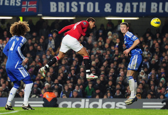 LONDON, ENGLAND - FEBRUARY 05: Gary Cahill of Chelsea (R) fails to stop Javier Hernandez of Manchester United (C) scoring their third goal with a header during the Barclays Premier League match between Chelsea and Manchester United at Stamford Bridge on F