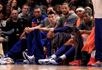 NEW YORK, NY - MARCH 28: (C) Jeremy Lin #17 of the New York Knicks sits on the bench against the Orlando Magic at Madison Square Garden on March 28, 2012 in New York City. NOTE TO USER: User expressly acknowledges and agrees that, by downloading and/or us