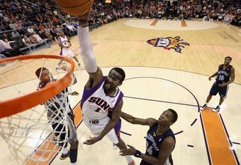 PHOENIX - NOVEMBER 25:  Amar'e Stoudemire #1 of the Phoenix Suns slam dunks the ball against the Memphis Grizzlies during the NBA game at US Airways Center on November 25, 2009 in Phoenix, Arizona. The Suns defeated the Grizzlies 126-111.  NOTE TO USER: U