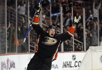 ANAHEIM, CA - MARCH 02:  Corey Perry #10 of the Anaheim Ducks celebrates Ryan Getzlaf's (not pictured) go ahead goal late in the third period against the Calgary Flames at Honda Center on March 2, 2012 in Anaheim, California. The Ducks defeated the Flames