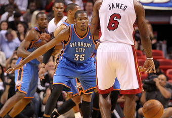 MIAMI, FL - MARCH 16:  LeBron James #6 of the Miami Heat is guarded by Kevin Durant #35 of the Oklahoma City Thunder during a game at American Airlines Arena on March 16, 2011 in Miami, Florida. NOTE TO USER: User expressly acknowledges and agrees that, b