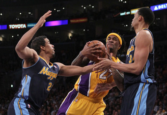 LOS ANGELES, CA - MAY 08:  Jordan Hill #27 of the Los Angeles Lakers grabs the ball between Andre Miller #24 and JaVale McGee #34 of the Denver Nuggets in the first quarter in Game Five of the Western Conference Quarterfinals in the 2012 NBA Playoffs on M