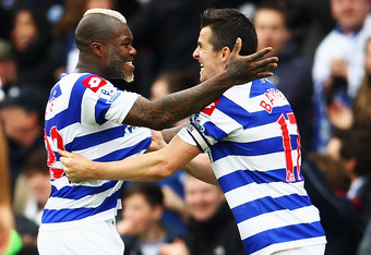 LONDON, ENGLAND - MAY 06:  Djibril Cisse (L) of Queens Park Rangers celebrates with team mate Joey Barton (R) after scoring during the Barclays Premier League match between Queens Park Rangers and Stoke City at Loftus Road on May 6, 2012 in London, Englan