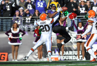 BALTIMORE, MD - DECEMBER 24:  Mike Adams #20 of the Cleveland Browns is called for interference against Torrey Smith #82 the Baltimore Ravens at M&T Bank Stadium on December 24. 2011 in Baltimore, Maryland. The Ravens lead the Browns 17-00 at the half. (P